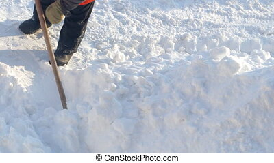 Janitor throws the snow - The janitor throws the snow shovel