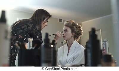 Make-up artist doing makeup bride - Make-up artist doing...