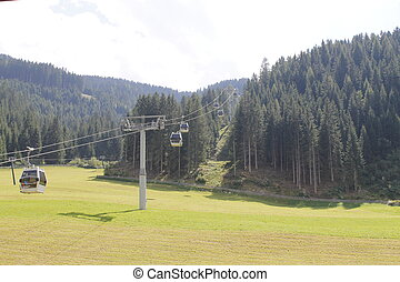 Chairlift ski lift in european Alps. Transporting hikers in...