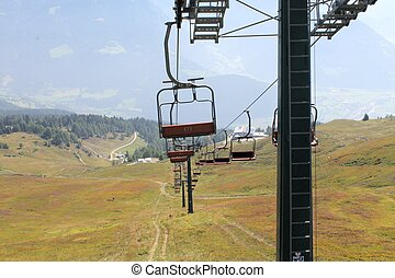 Chairlift - ski lift in european Alps. Transporting hikers...