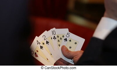 playing poker cards in man hand - man holding poker cards in...