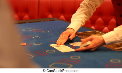 dealer lays out the cards - playing poker. dealer lays out...