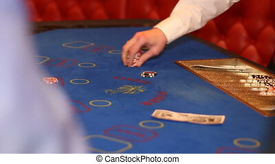 dealer gives the chips to player won in casino - dealer...