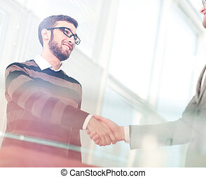 Close up of business handshake in the office - Business man...