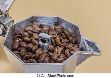 coffeepot and coffee - A coffeepot with coffe beans