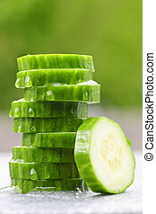 Sliced cucumber - Stack of fresh organic green cucumber...