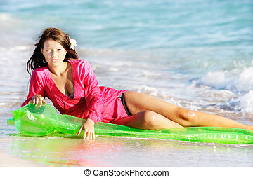 young beautiful woman on beach