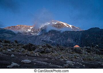 Morning sun illuminates Kibo, Mount Kilimanjaro, Tanzania -...