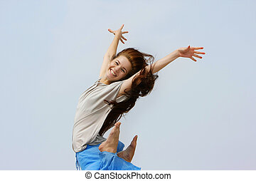 young happy girl jumping isolated