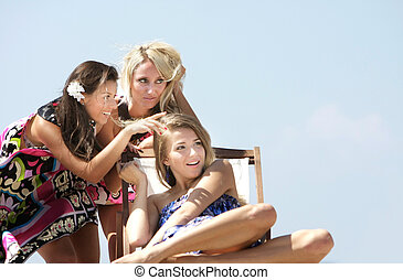 three young girls outdoors