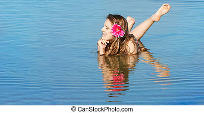 young attractive woman in water