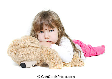 sad girl with teddybear over white