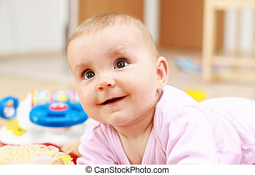 Lovely child playing - Portrait of cute newborn playing with...