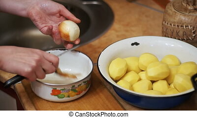 Cleaning Potatoes in the Home Kitchen. Slow Motion -...