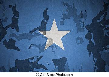 flag of somalia on the khaki texture . military concept -...