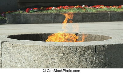 Eternal Flame burning in Velikiy Novgorod Kremlin - People...