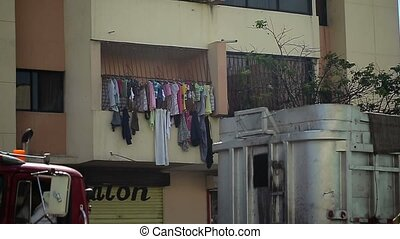 Clothes drying on the rope at balcony in the street