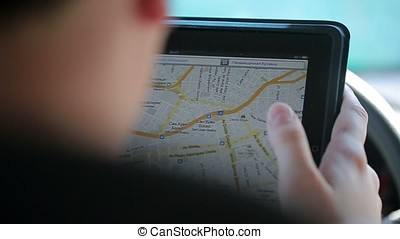 Man watching map on tablet