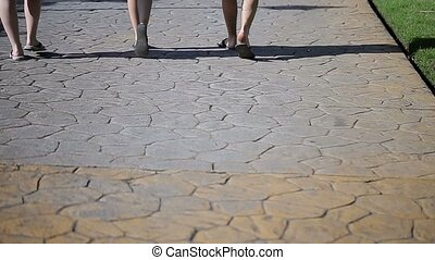 Three people walking at summer
