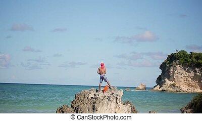 Fisherman near Caribbean sea at sunny day