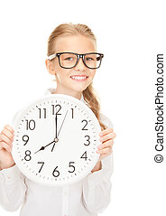 girl holding big clock - picture of girl holding big clock...