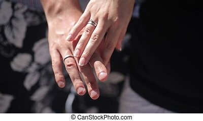 Young couple touching each other hands on vacation