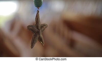 Starfish pendant jewelry in shop