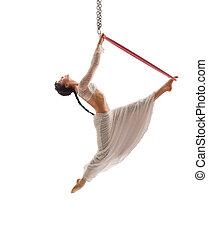 Side view of aerial acrobat  performing with hoop