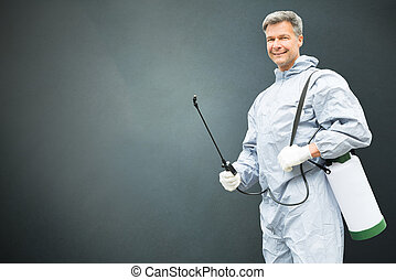Pest Control Worker In Protective Workwear With Pesticides...