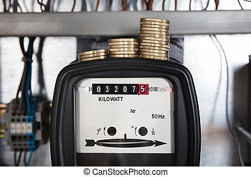 Stacked Coin On Kilowatt Meter - Close-up Of A Stacked Coin...