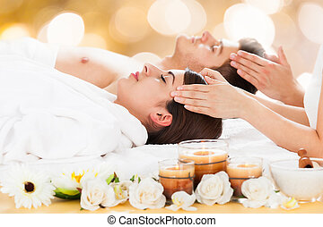Couple Receiving Head Massage At Spa