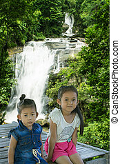 Asian children girl at Sirithan waterfall in Doi Inthanon , Chomthong chaingmai Thaland