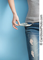 woman showing her empty pockets