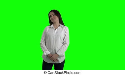 Woman looking at something against green screen