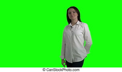 Woman in white shirt showing ok sign against a green screen
