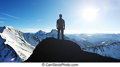 Silhouette Of A Man Standing On Mountain