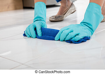 Person Cleaning Floor With Cloth - Close-up Of A Person...