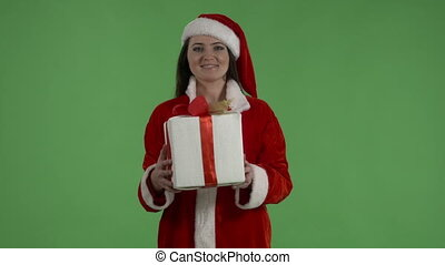 Woman wearing Santa Clause costume holding Christmas present green screen