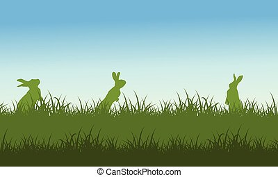 Silhouette of rabbit on field scenery