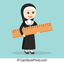 nun holding giant ruler