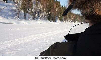 A trip on a snowmobile - a man rides on a snowmobile on ice...