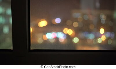 Blur lights of night city view from high rise apartment window