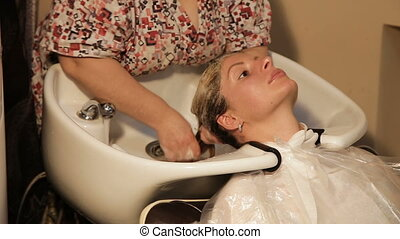 Hair washing at a hairdressing salon, - Hair care in modern...
