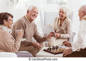 Playing chess together - Aged people playing chess together...