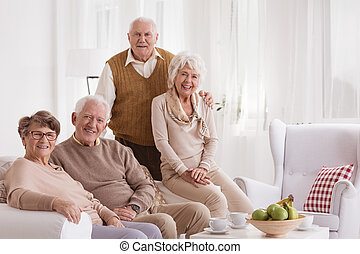 Seniors at day-care center - Group of happy seniors at...