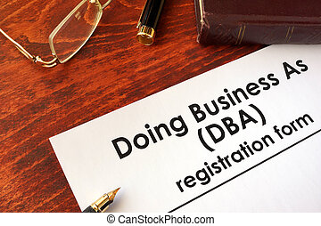 DBA Registration doing business as form on a table.