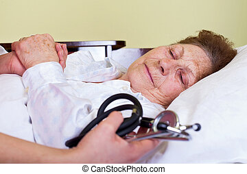 Sick elderly woman - Picture of a sick elderly woman with...