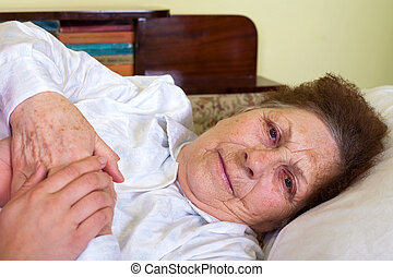Bedridden elderly woman - Picture of a bedridden elderly...