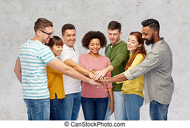 international group of happy people holding hands -...