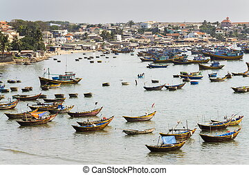 Colorful fishing boats in popular tourist destination Mui...